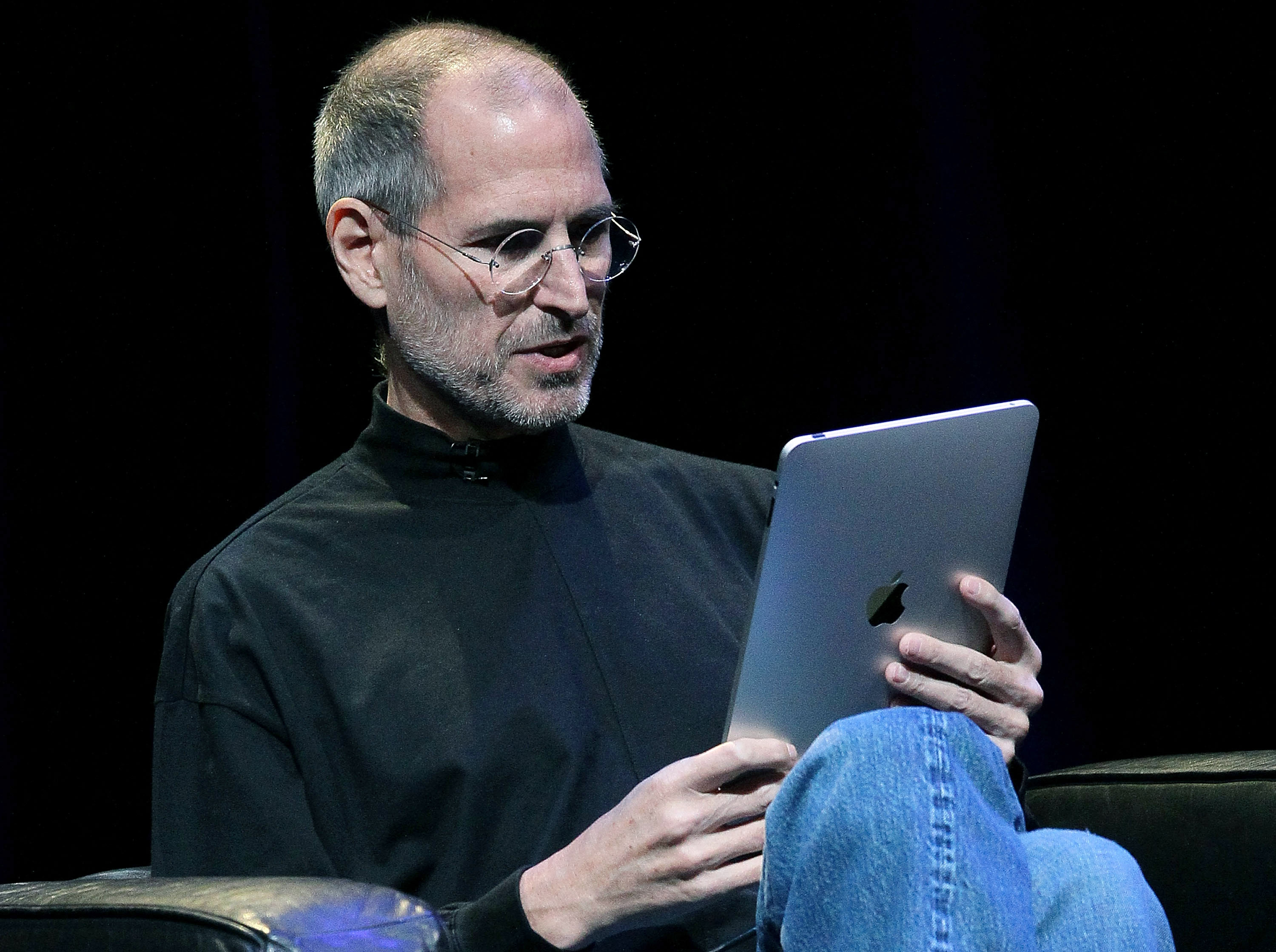 SAN FRANCISCO - JANUARY 27:  Apple Inc. CEO Steve Jobs demonstrates the new iPad as he speaks during an Apple Special Event at Yerba Buena Center for the Arts January 27, 2010 in San Francisco, California. Apple introduced its latest creation, the iPad, a mobile tablet browsing device that is a cross between the iPhone and a MacBook laptop.  (Photo by Justin Sullivan/Getty Images)